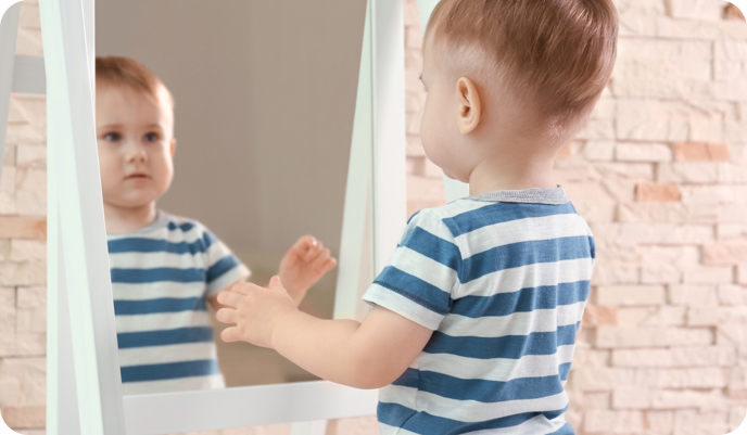 toddler looking in mirror